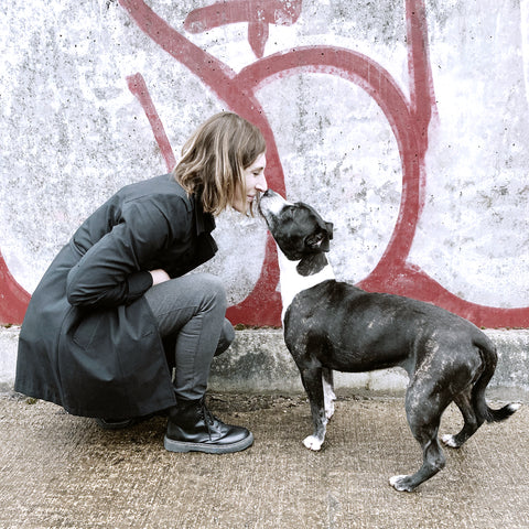 Dotty Dog Art owner nose to nose with staffy
