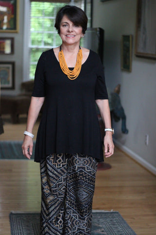 Printed pants, Black top and handcrafted beaded necklace in orange