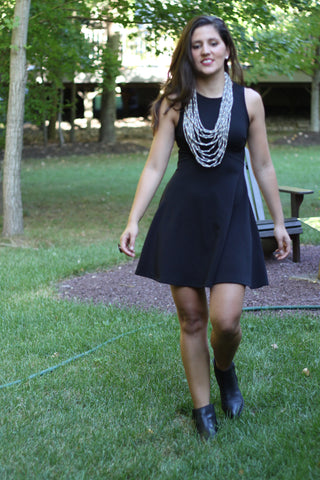 little black dress and grey statement necklace