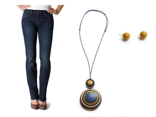 Blue pendant necklace and blue jeans