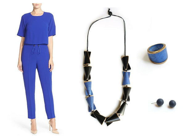 Blue and black handcrafted necklace with a blue jumpsuit