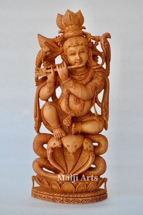 Baby Krishna sitting on snack fine wooden hand carved statue - Malji Arts