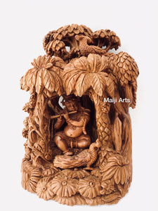 Sandalwood Baby krishna under tree playing flute - Malji Arts