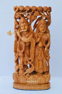 Wooden hand carved radha krishna jodi under tree - Malji Arts