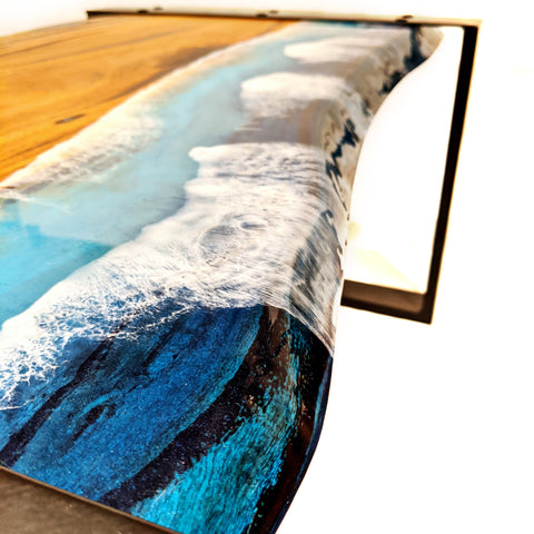 marri coffee table with ocean epoxy resin coat and steel legs. Marri slab furniture that's made in Western Australia