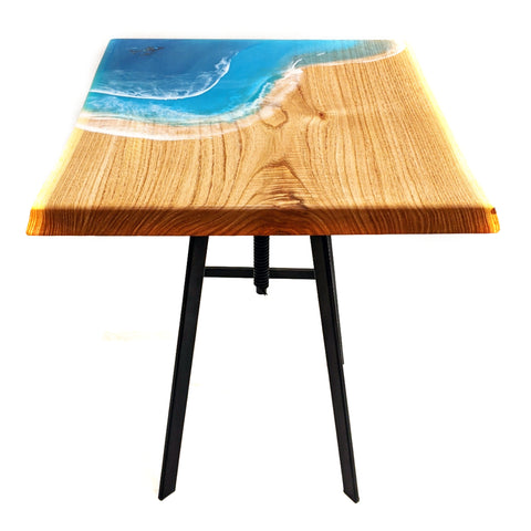 small timber slab table with epoxy resin ocean waves on top. Abalone shell whale and calf swimming in resin. industrial legs