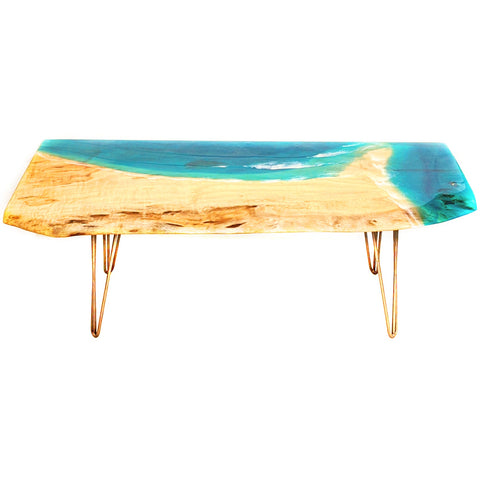 camphor laurel coffee table with ocean epoxy resin top. Hair pin steel legs. Resin waves in turquoise blue