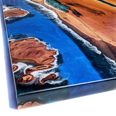 australian hardwood sheoak coffee table with deep pour river resin. Ocean theme epoxy with waves washing around burls