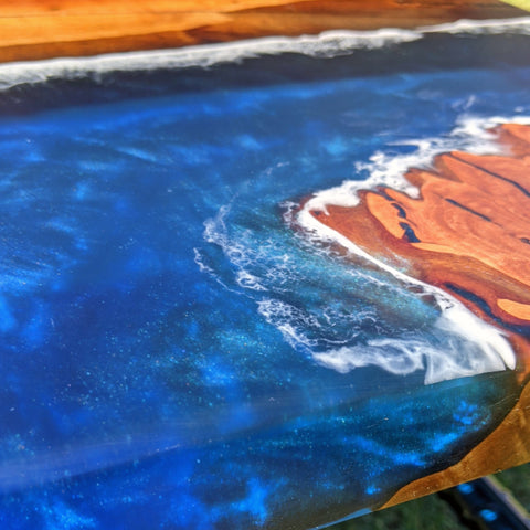 metallic blue pigment in turquoise epoxy resin. River table made with sheoak ocean theme with waves