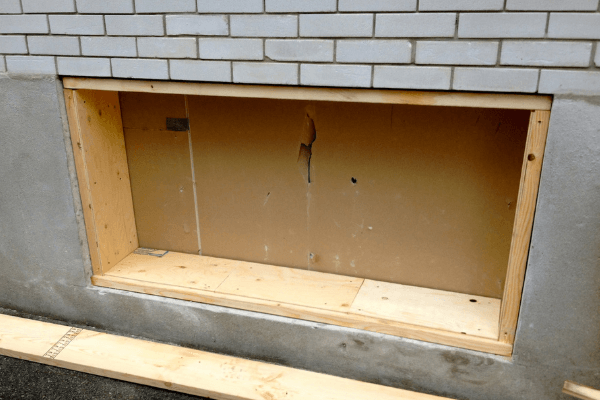 Egress window opening with frame installed