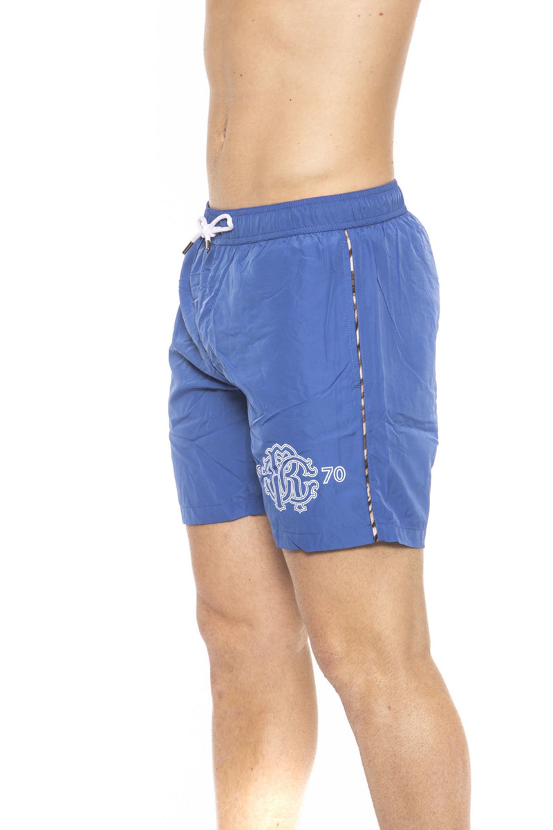 Blue Beachwear Boxer With Pockets. Front Logo Print. Internal Net. Back Pocket. Spotted Edges.