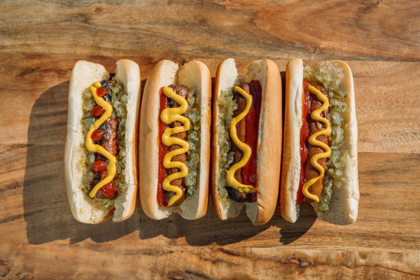 Four Hot Dogs with Mustard, Ketchup and Relish