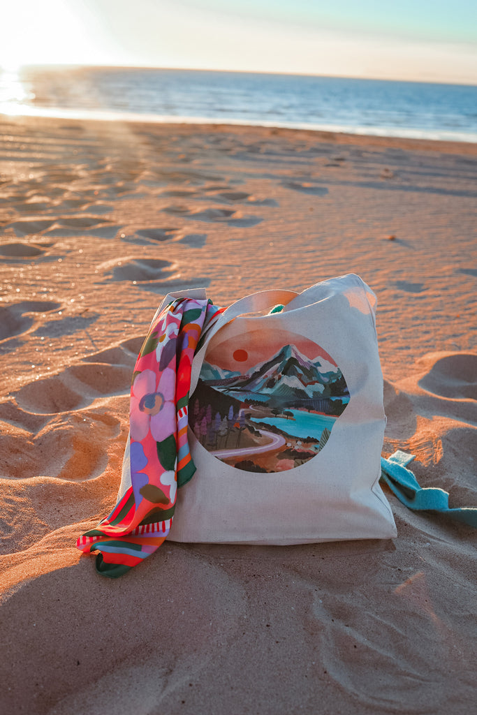mount cook tote bag up close with scarf on beach