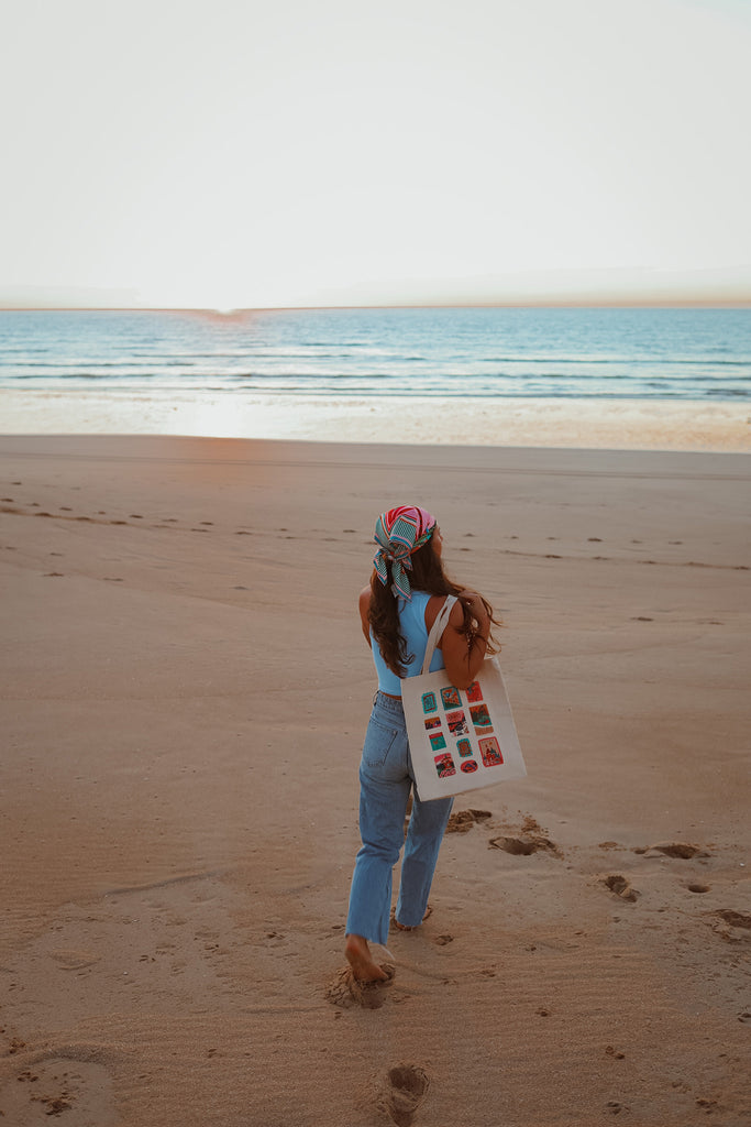 girl on beach from behind with tote bag and scarf bandana