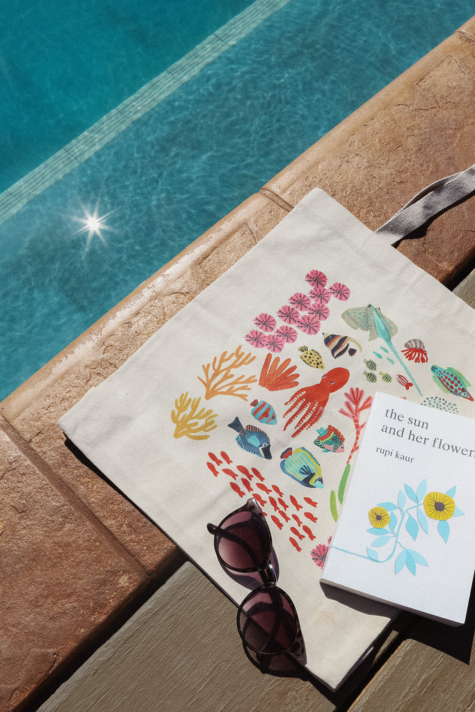 under the sea tote bag by pool with book and sparkle