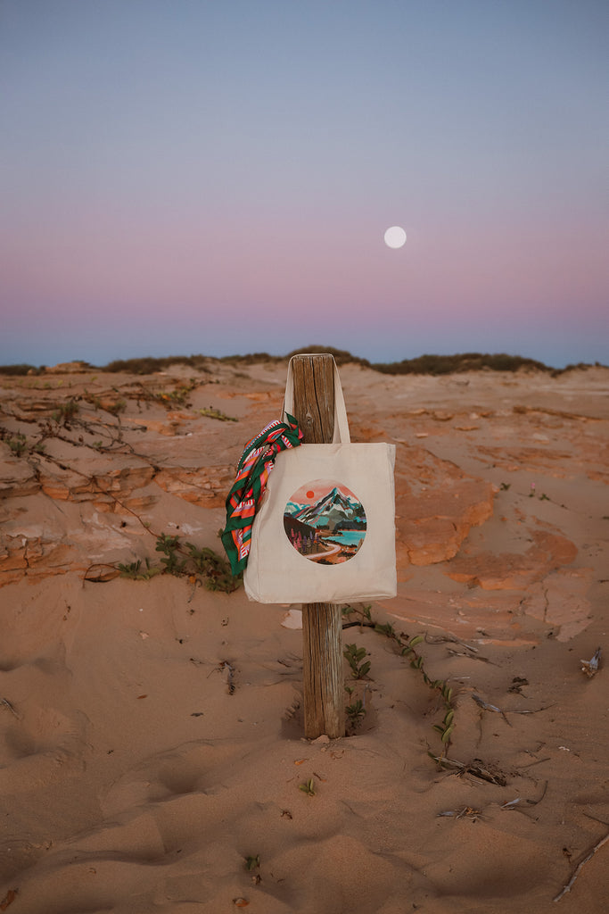 21 mount cook tote bag hanging on a post with scarf and moon