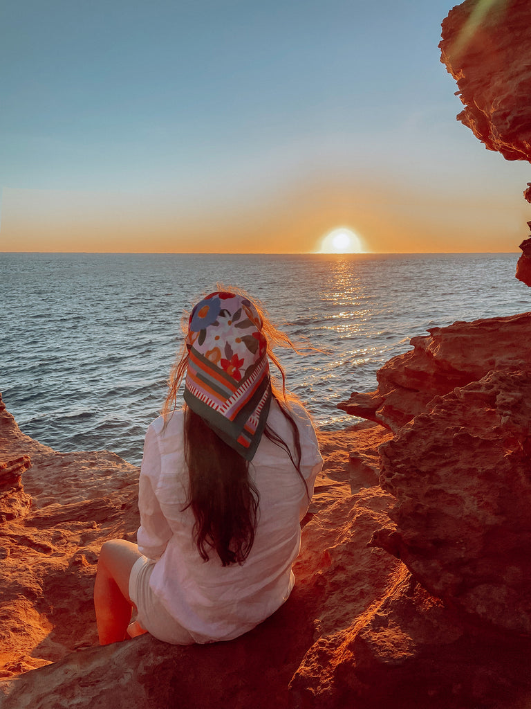 27 back of head showing scarf watching the sunset red cliffs