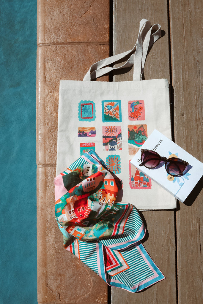 travel stamp tote bag with amalfi silk scarf by pool
