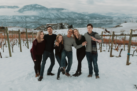 Happy and silly Smith family photo in snowy vineyard