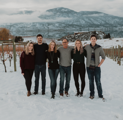 Smith family smiling in snowy vineyard