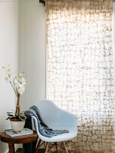 Ceranchia open weave curtain adds light but blocks outside images.  Custom sizes available.