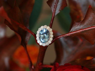 Latest Advert - 18ct White Gold Diamond and Aquamarine Oval Cluster Ring