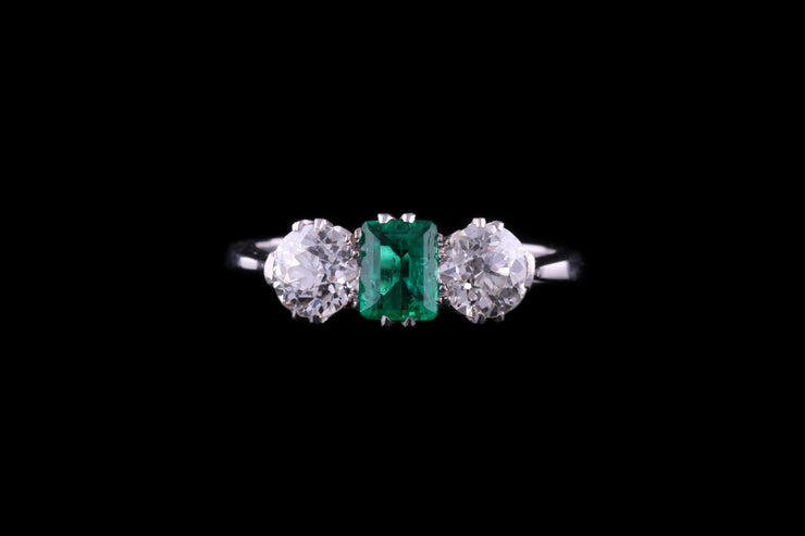 Platinum Diamond and Emerald Three Stone Ring