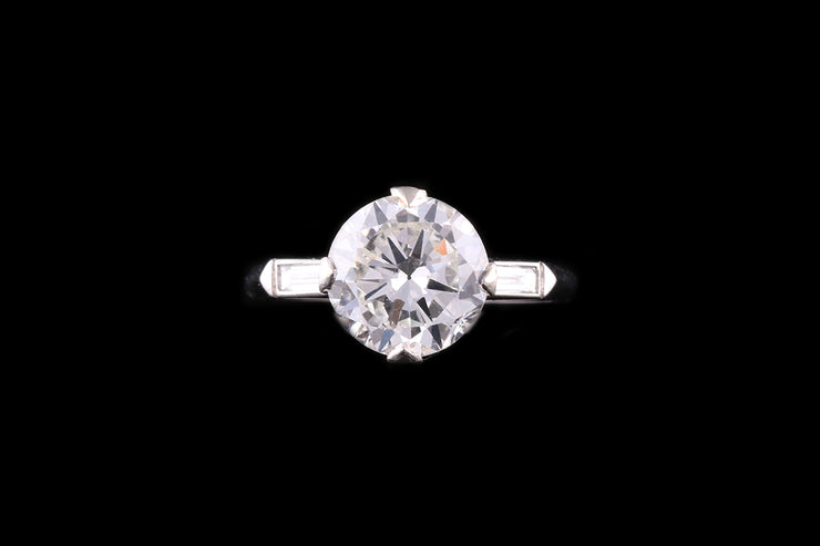 Platinum Diamond Single Stone Ring with Baguette Diamond Shoulders