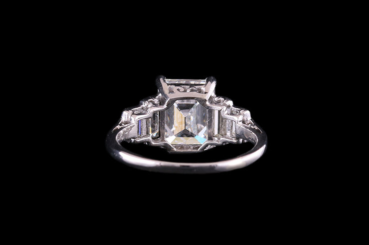 Platinum Emerald Cut Diamond Ring With Graduated Shoulders