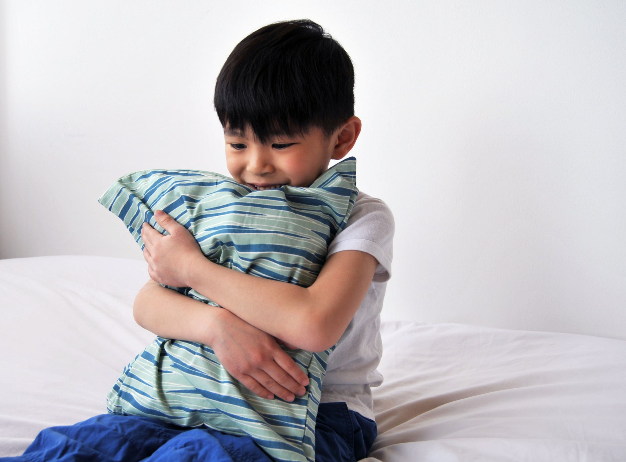 Boy hugging Toddler pillow