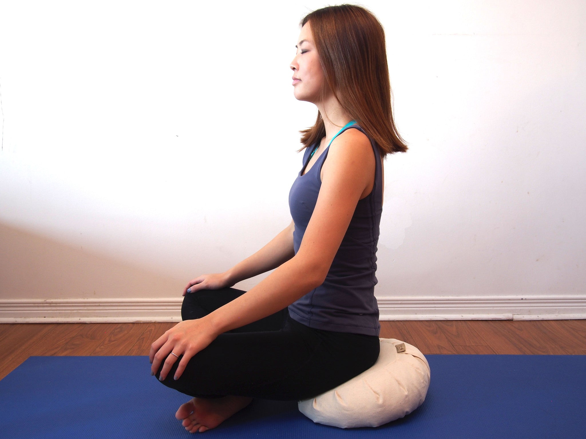 Meditating on zafu cushion