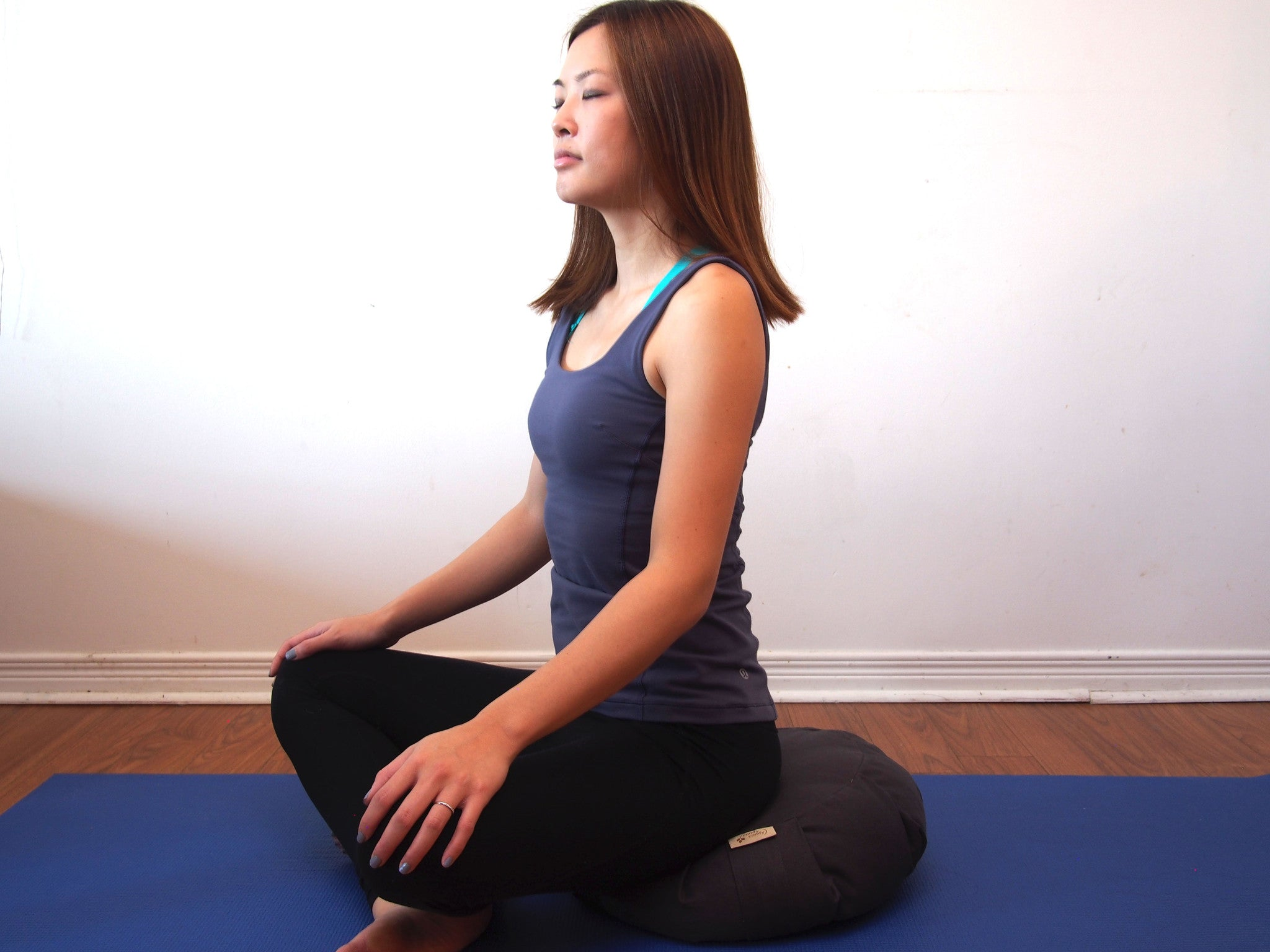 Meditating on Zafu Meditation Cushion