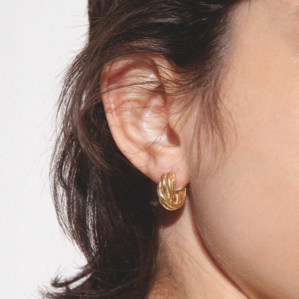 BAR Jewellery Sustainable Small Braid Earrings In Gold Hoop Style, Placed On Ear