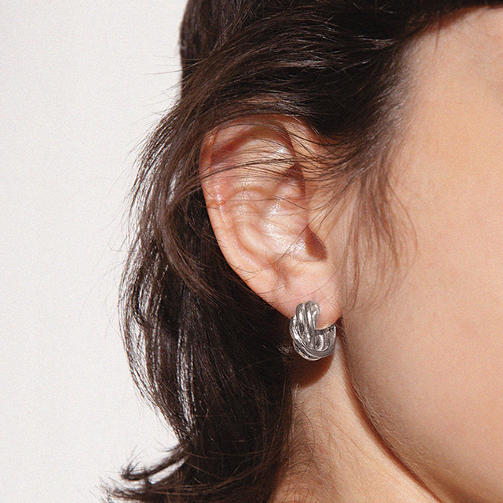 BAR Jewellery Sustainable Small Braid Earrings In Silver Hoop Style, Placed On Ear