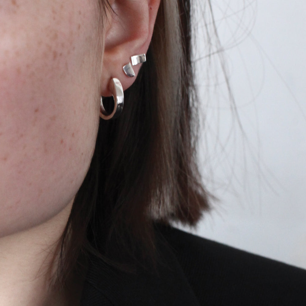 BAR Jewellery Sustainable Coppia And Taper Earrings In Silver, Placed On Ear