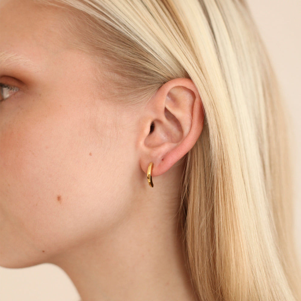 BAR Jewellery Sustainable Luna Stud Earrings In Gold, Placed On The Ear
