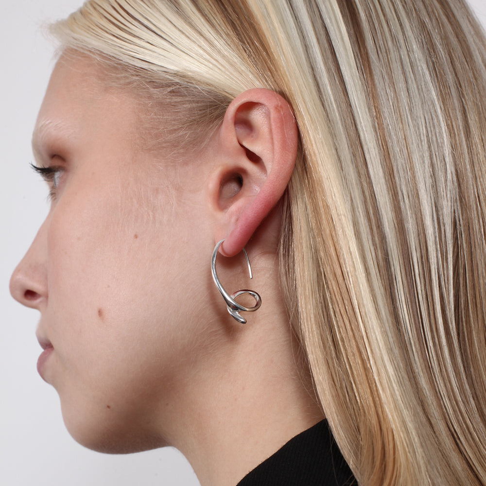 BAR Jewellery Sustainable Phi Earrings In Silver Drop Style, Placed On Ear