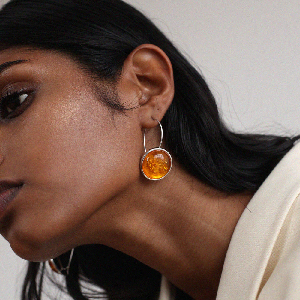 BAR Jewellery Sustainable Arp Earrings In Recycled Sterling Silver With Burnt Orange Resin, Placed On Ear