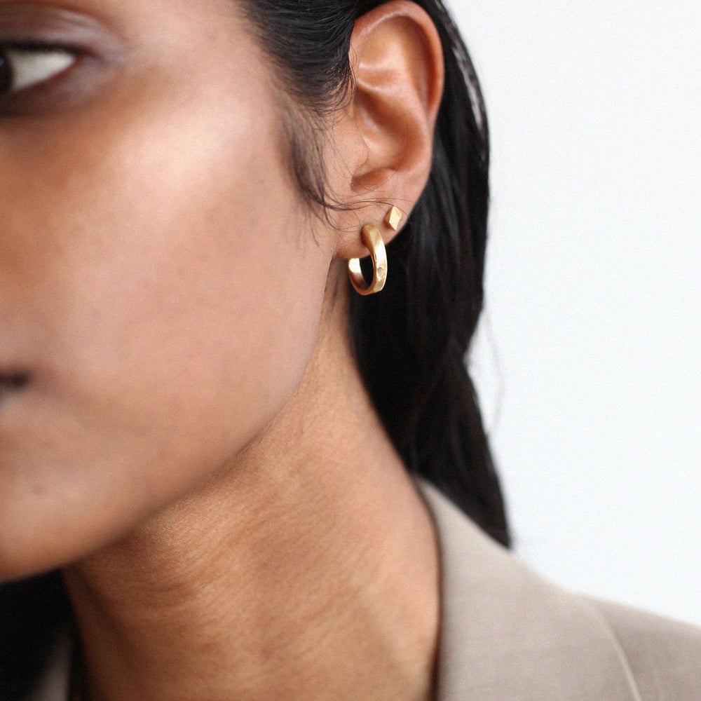 BAR Jewellery Sustainable Coppia and Taper Earrings In Gold, Worn On Ear