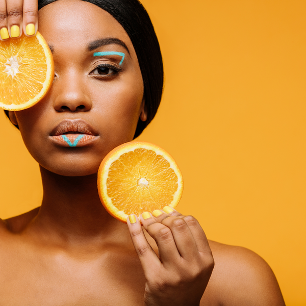 Efani Skincare | Woman with Orange Slice