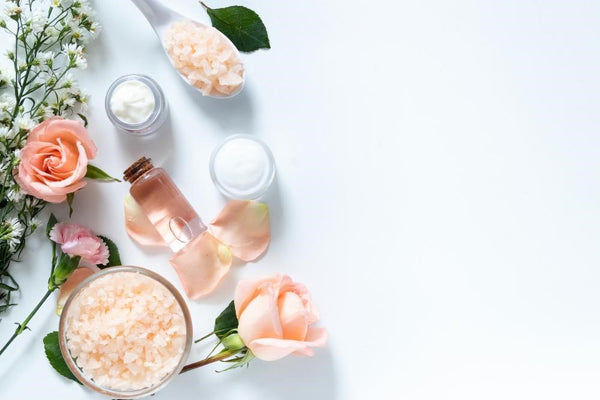 Natural skin glow oil, scrub, and cream with pink roses