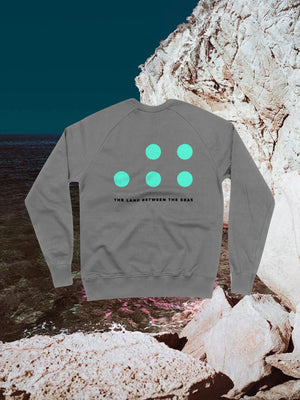 Open image in slideshow, The Land Between The Seas Long Sleeve Sweatshirt with five blue dots on the back with TLBTS written below