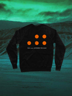 The Land Between The Seas Grey Swearshirt in Black with five orange dots on the back of the sweatshirt