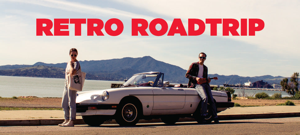 retro roadtrip featuring ukulele products on the road with a vintage alfa romeo