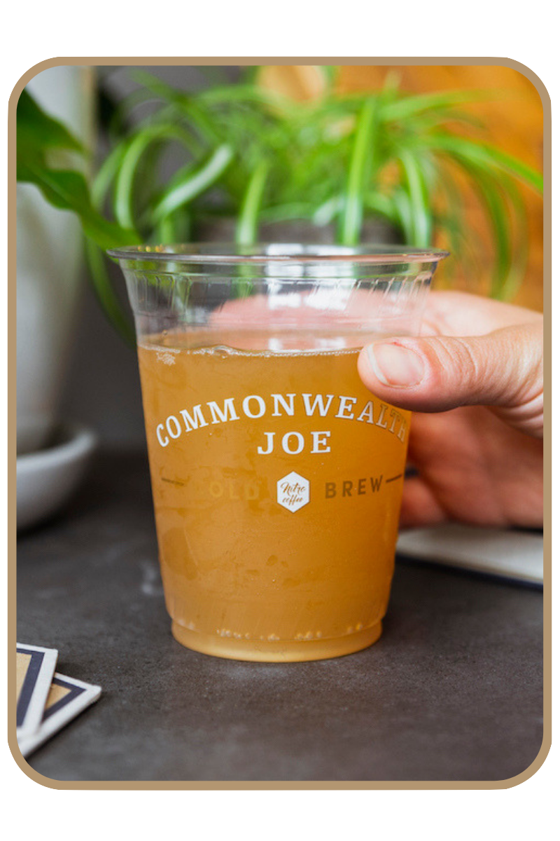Close-up of kombucha fizzing in a Commonwealth Joe cup