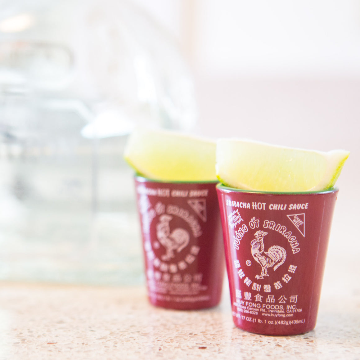 Sriracha Shot Glasses With Tequila And Limes