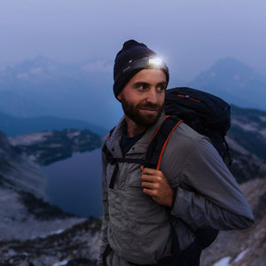 Man backpacking with biolite headlamp