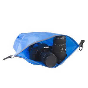 Blue Lightweight Dry Bag with camera gear laying inside open bag