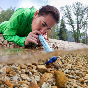 LifeStraw Personal Water Filter Woman using in stream