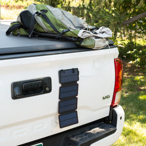 QuadraPro Solar Power Bank magnetic hanging on truck tailgate
